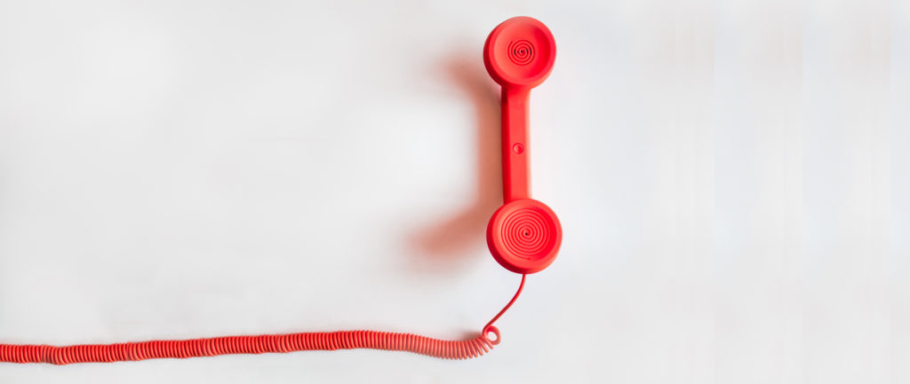 Red landline phone to contact SBS