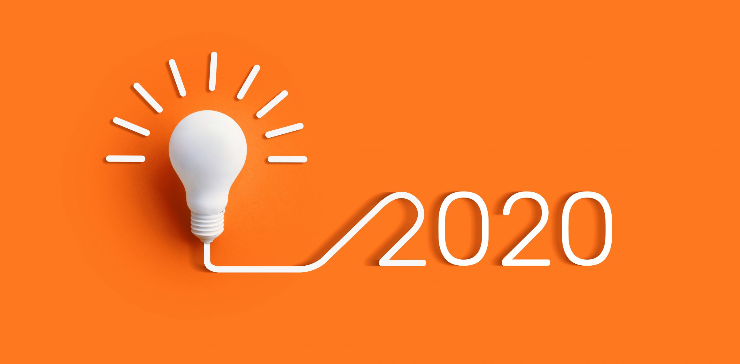 2020 creativity inspiration concepts with lightbulb on color background.