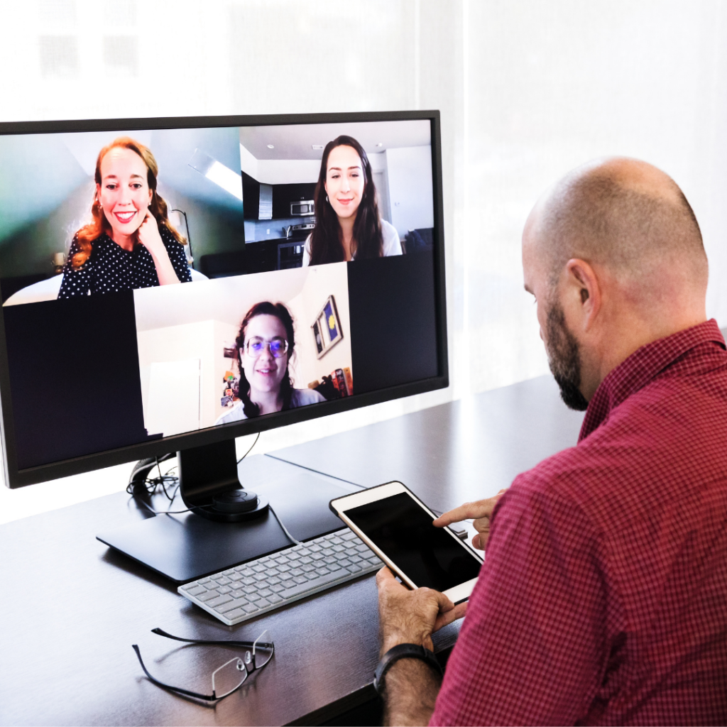 Image shows a man voting on his phone while in a virtual meeting.